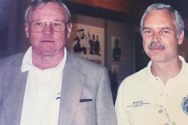 Marcio Barbosa and Neil Armstrong, NASA.