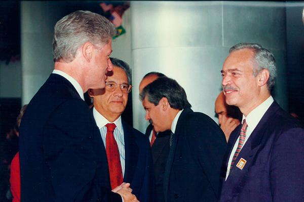 Marcio Barbosa and Bill Clinton in Brazil.